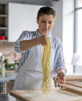 woman making pasta