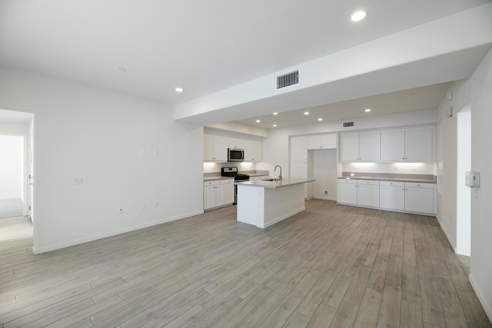 Great Room to Kitchen | Residence 2 | Aspire | New Homes in Rancho Cucamonga, CA | Van Daele Homes
