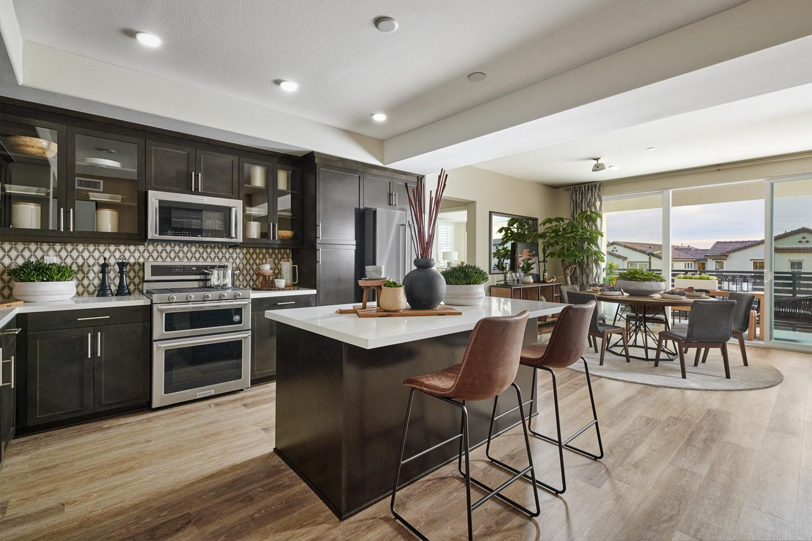 Kitchen to Dining Area | Residence 5 | Aspire | New Homes in Rancho Cucamonga, CA | Van Daele Homes