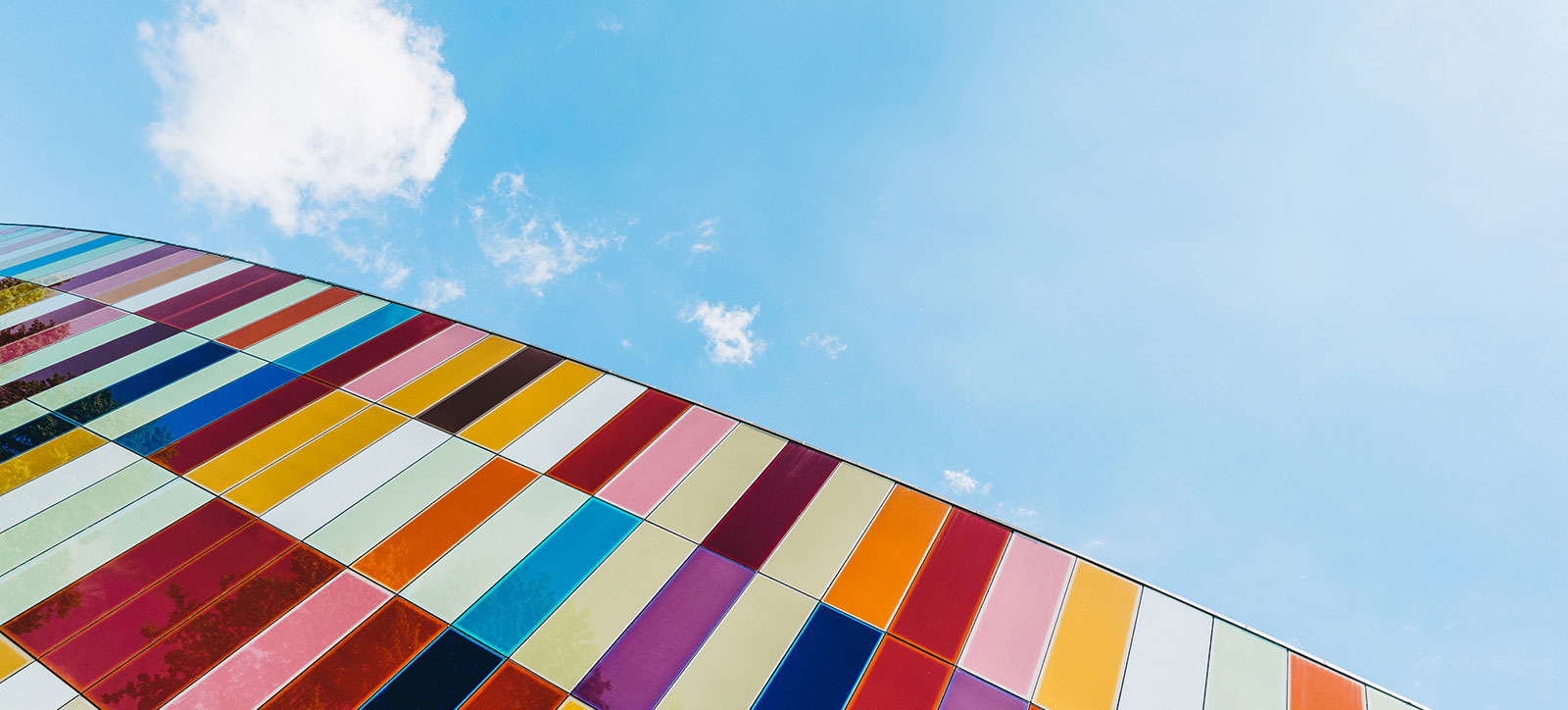 blue sky with colorful wall