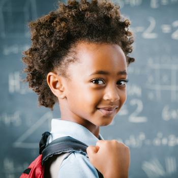 girl holding red backpack